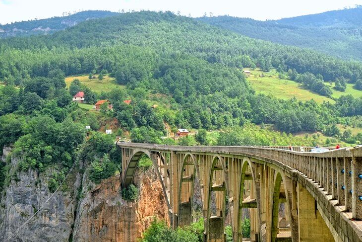 The 7 day self-drive Discover Montenegro tour takes you Montenegro's best spots, like the Tara Djurdjevca Bridge near Zabljak.