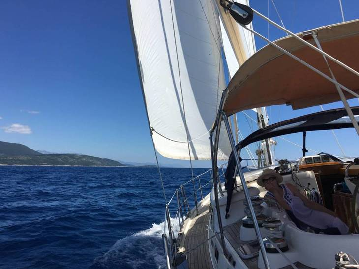 Dolphin watching in Montenegro aboard a luxury ocean-going Discovery 55 sailing yacht.