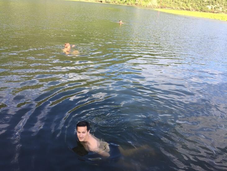 Swimming in Rijeka Crnojevica, part of Skadar Lake, on the Great Montenegro Tour.
