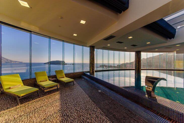 Hotel Tre Canne on the Budva Riviera, Montenegro has a pool and restaurant overlooking Budva and Sveti Nikola Island