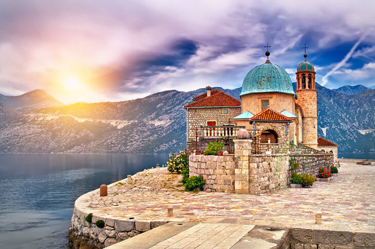 Our Lady of the Rocks, the church island just off the coast of Perast in the Bay of Kotor, Montenegro. Take a short boat ride to visit the island and take a guided tour for just 1 Euro.