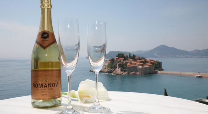 Sveti Stefan Hotel Romanov is a budget-friendly luxe option overlooking the hamlet and island of Sveti Stefan, Montenegro.