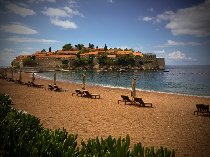 Visit Montenegro and stay in the luxurious surrounds of Aman Sveti Stefan, a 15th century island resort.